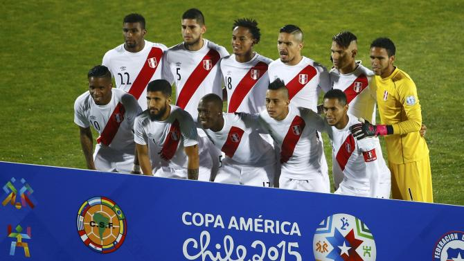 The Peru team poses for their team picture ahead of their Copa America 2015 semi-final soccer match against Chile at the National Stadium in Santiago