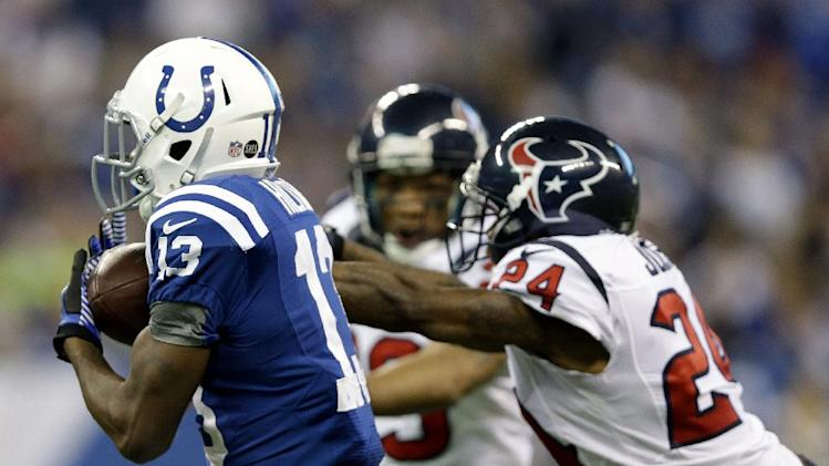 Indianapolis Colts' T.Y. Hilton (13) makes a 70-yard touchdown reception against Houston Texans' Johnathan Joseph (24) during the second half of an NFL football game, Sunday, Dec. 30, 2012, in Indianapolis. (AP Photo/Michael Conroy)