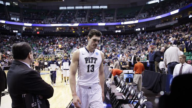 Pittsburgh's Steven Adams (13) walks off the court after his team lost to Wichita State 73-55 in a second-round game in the NCAA college basketball tournament in Salt Lake City Thursday, March 21, 2013. (AP Photo/Rick Bowmer)
