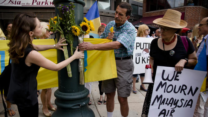 Flowers are arranged in a makeshift memorial during a vigil for victims of the Malaysia Airlines Flight 17, Friday, July 18, 2014, in Philadelphia. The Malaysia Airlines jetliner was carrying 298 people when it was shot down over eastern Ukraine on Thursday. (AP Photo/Matt Rourke)