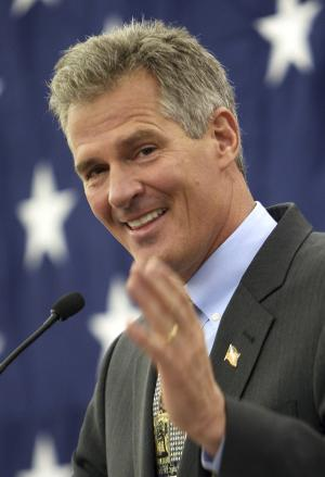 FILE - In this March 14, 2014 file photo, former Massachusetts Senator Scott Brown acknowledges his wife Gail in Nashua, N.H., as he announces plans to form an exploratory committee to enter New Hampshire's U.S. Senate race against Democratic Sen. Jeanne Shaheen. Brown said Monday, April 7, 2014, he will kick off his campaign for U.S. Senate Thursday night in Portsmouth, N.H. (AP Photo/Jim Cole, File)