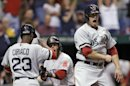 Boston Red Sox&#039;s Daniel Nava, right, celebrates with teammates Pedro Ciriaco, left, and Dustin Pedroia, center, after scoring on a three-run, ninth-inning double by Will Middlebrooks off Tampa Bay Rays relief pitcher Fernando Rodney during a baseball game Thursday, May 16, 2013, in St. Petersburg, Fla. (AP Photo/Chris O&#039;Meara)