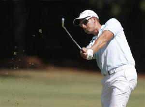 Henrik Stenson hits from the fairway on the third hole during the Tour Championship golf tournament in Atlanta