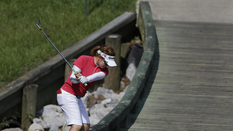 Eunjung Yi hits her ball from the bridge that crosses the water on the 18th fairway after her ball rolled several hundred yards back down the cart path during second round play in the Mobile Bay LPGA Classic golf tournament at the Robert Trent Jones Golf Trail at Magnolia Grove in Mobile, Ala. Friday, May 17, 2013. (AP Photo/Dave Martin)