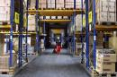 Worker pulls a pallet truck through one of the warehouses at toy company Simba Dickie's logistics centre in Sonneberg