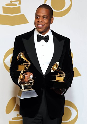 FILE - In this Feb. 10, 2013 file photo, Jay-Z poses backstage with the awards for best rap/sung collaboration for &quot;No Church in the Wild&quot; and best rap performance for &quot;N****s in Paris&quot; at the 55th annual Grammy Awards, in Los Angeles. Jay-Z is among 11 celebrities and government officials whose private financial information appears to have been posted online by a site that began garnering attention on Monday, March 11, 2013. (Photo by Matt Sayles/Invision/AP, File)