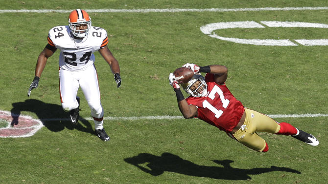San Francisco 49ers wide receiver Braylon Edwards (17) makes a catch in front of Cleveland Browns cornerback Sheldon Brown (24) in the first quarter of an NFL football game in San Francisco, Sunday, Oct. 30, 2011. (AP Photo/Ben Margot)