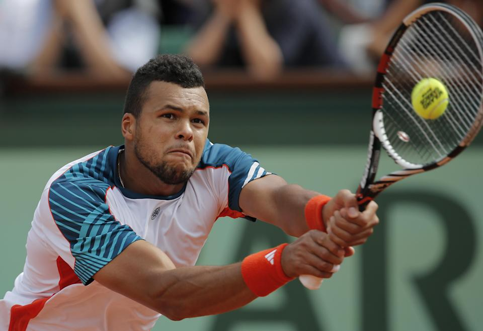 Jo-Wilfried Tsonga of France returns in his quarter final match against Novak Djokovic of Serbia at the French Open tennis tournament in Roland Garros stadium in Paris, Tuesday June 5, 2012. (AP Photo/Christophe Ena)