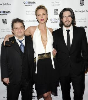 Actor Patton Oswalt, left, actress Charlize Theron and director Jason Reitman attend the IFP's 21st Annual Gotham Independent Film Awards at Cipriani Wall Street on Monday, Nov. 28, 2011 in New York. (AP Photo/Evan Agostini)