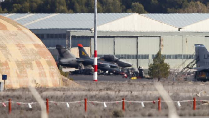 Fighter planes are seen along with the wreckage of a Greek F-16 which crashed during takeoff on Monday, inside the Los Llanos military base in Albacete