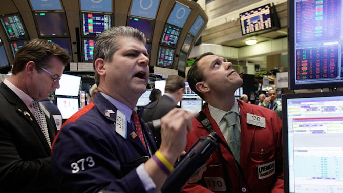 Traders work on the floor of the New York Stock Exchange Monday, Feb. 27, 2012. U.S. stocks pulled back Monday from some of their highest levels in three and a half years. (AP Photo/Richard Drew)