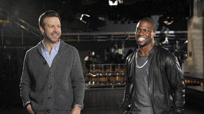 """This Feb. 26, 2013 photo released by NBC shows cast member Jason Sudeikis, left, and guest host Kevin Hart during rehearsals for """"saturday Night Live,"""" in New York.  Hart will host the show on Saturday, March 2, with musical guest Macklemore & Ryan Lewis. (AP Photo/NBC, Dana Edelson)"""