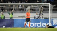 Dirk Kuyt, left, of the Netherlands leaves the scene while Finland&#39;s goalkeeper Lukas Hradecky lies on the ground after the Dutch team&#39;s second goal, scored by Luuk de Jong, during the UEFA Euro 2012 Group E qualifying soccer match Finland vs the Netherlands at the Olympic Stadium in Helsinki, Finland, on Tuesday Sept. 6, 2011. (AP Photo/LEHTIKUVA, Martti Kainulainen) FINLAND OUT - NO SALES