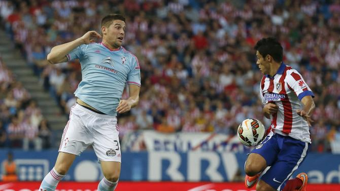 Atletico Madrid's Raul Jimenez controls the ball next to Celta Vigo's Andreu Fontas during their Spanish first division soccer match at Vicente Calderon stadium in Madridrid