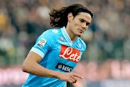 Napoli&#39;s Uruguayan striker Edinson Cavani celebrates after scoring against Parma during the Italian Serie A football match Parma vs. Napoli on January 27, 2013 at Parma&#39;s Tardini Comunal stadium. Cavani scored his 18th league goal of the season to take Napoli to within three points of Serie A leaders Juventus as Parma lost their unbeaten home record on Sunday