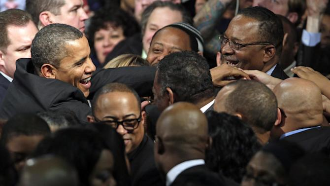President Barack Obama shakes hands with the audience after speaking at Hyde Park Academy, Thursday, Feb. 14, 2013, in Chicago. (AP Photo/M. Spencer Green)