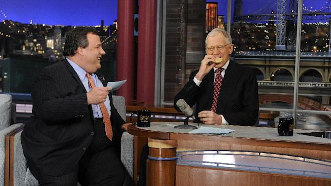 """In this photo released by CBS Broadcasting, New Jersey Gov. Chris Christie, left, chats with David Letterman, right, during his first visit to CBS' """"Late Show with David Letterman,"""" on Monday, Feb. 4, 2013 in New York.  (AP Photo/CBS Broadcasting, Jeffrey Neira)"""