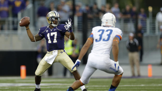 Washington quarterback Keith Price (17) looks to pass around Boise State's Gabe Perez (33) in the first half of a NCAA college football game, Saturday, Aug. 31, 2013, in Seattle. (AP Photo/Ted S. Warren)