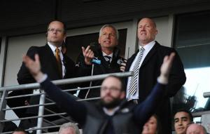 Newcastle United's manager Pardew watches from the stand after being sent off during their English Premier League soccer match against Hull City at the KC Stadium