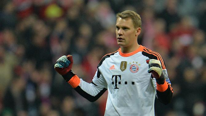 Bayern's goalkeeper Manuel Neuer celebrates after the Champions League round of the last 16 second leg soccer match between FC Bayern Munich and Arsenal FC in Munich, Germany, on Tuesday, March 11. 2014. The match finished 1:1