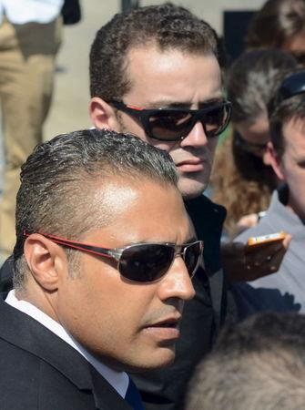 Al Jazeera television journalists Mohamed Fahmy and Baher Mohamed talk to the media outside Tora prison in Cairo