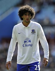 Marouane Fellaini says he will stay at Everton if the Toffees qualify for the Champions League