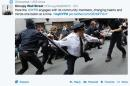 This frame grab from a Twitter post from @OccupyWallStNYC shows a news photo of a New York City police officer wielding a baton during an Occupy Wall Street action in New York. The photo was posted in response to a Twitter request by the NYPD to offer up feel-good photos of people posing with police officers. NYPD Commissioner William Bratton on Wednesday, April 23, 2014 admits he was caught off guard by the harsh response to a harmless attempt at community outreach on Twitter, but says he has no plans to abandon social media. (AP Photo/Twitter)