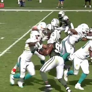 Miami Dolphins running back Daniel Thomas pushes through for 1-yard TD