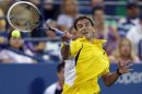 Tommy Robredo of Spain returns a forehand to Daniel Evans of Britain at the U.S. Open tennis championships in New York