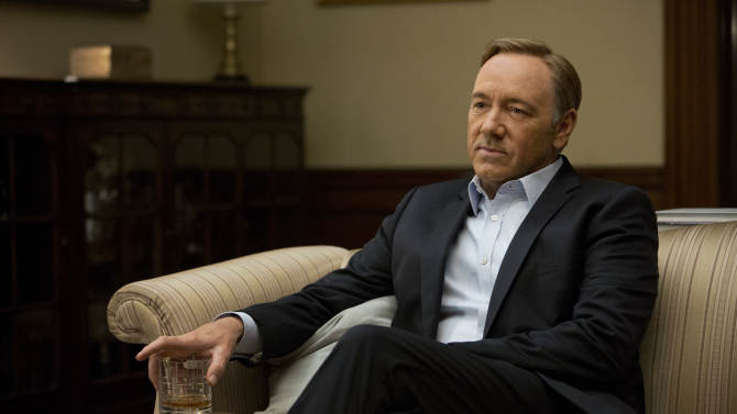 """This image released by Netflix shows Kevin Spacey in a scene from the Netflix original series, """"House of Cards,"""" an adaptation of a British classic. The 13-episode series was made available on Netflix on Feb. 1. (AP Photo/Netflix, Melinda Sue Gordon)"""