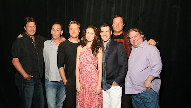 "This July 2012 publicity photo provided by the Science Channel shows the cast of ""Firefly,"" from left, Nathan Fillion, executive producer Tim Minear, Alan Tudyk, Summer Glau, Sean Maher, Adam Baldwin and executive story editor Jose Molina, reuniting for the 10 year anniversary of the series in the Science Channel Special, ""Firefly: Browncoats Unite,"" airing on Sunday, Nov. 11, 2012 at 10PM ET/PT. (AP Photo/Science Channel, James Aronovsky)"
