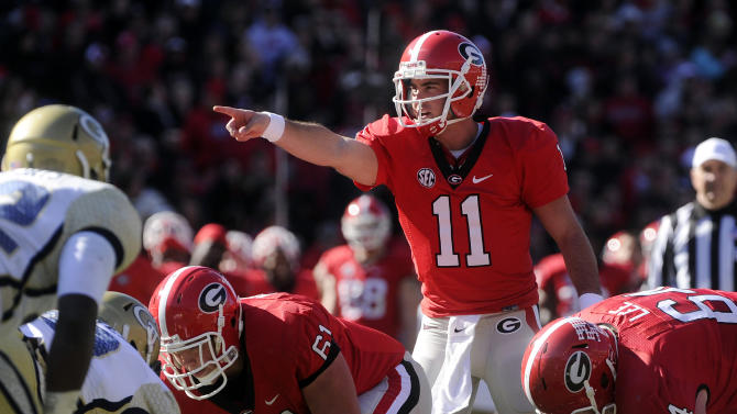 FILE - In this Nov. 24, 2012, file photo, Georgia quarterback Aaron Murray (11) directs this team against Georgia Tech during the second half of an NCAA college football game in Athens, Ga. Alabama's AJ McCarron and Murray have piloted their teams into the SEC championship game as the nation's two most efficient passers.(AP Photo/John Amis, File)