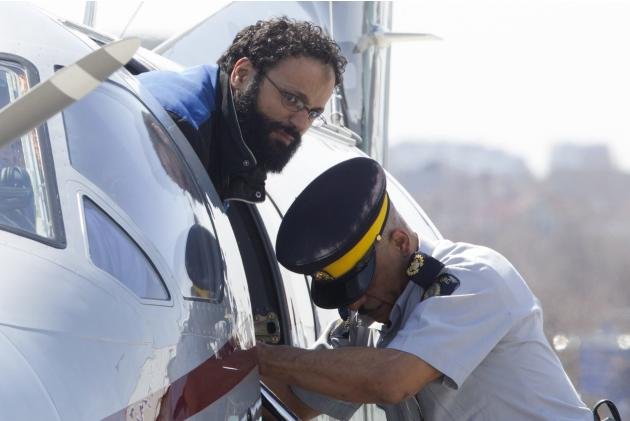 Chiheb Esseghaier, one of two men accused of plotting a terror attack on rail target, is led off a plane by an Royal Canadian Mounted Police (RCMP) officer at Buttonville Airport just north of Toronto