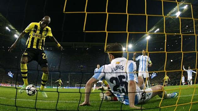 Borussia Dortmund's Felipe Santana (L) scores a third and winning goal against Malaga (Reuters)