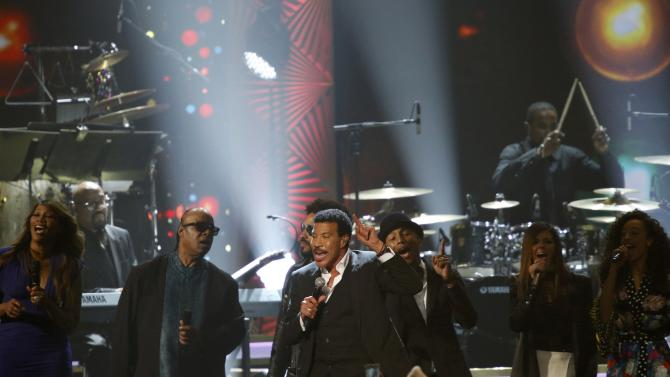 Musicians Adams, Wonder, Kravitz, Richie, Williams, Fairchild and Rae perform on stage at the 2016 MusiCares Person of the Year gala in Los Angeles