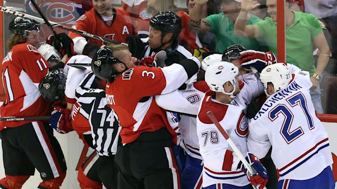 Montreal Canadiens players and Ottawa Senators players fight during the first period of Game 3 of their first-round NHL hockey Stanley Cup playoff series, Sunday, May 5, 2013, in Ottawa, Ontario. (AP Photo/The Canadian Press, Fred Chartrand)