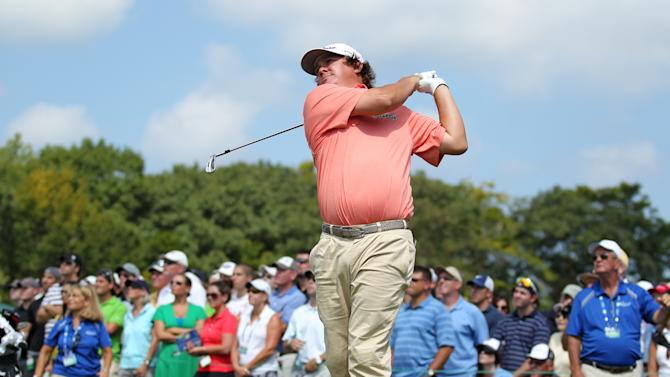 Jason Dufner hits his tee shot on the third hole during the second round of the Deutsche Bank Championship PGA golf tournament at TPC Boston in Norton, Mass., Saturday, Sept. 1, 2012. (AP Photo/Stew Milne)