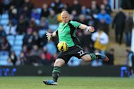 Keeper Brad Guzan, pictured, has been hailed as 'world-class' by Villa manager Paul Lambert