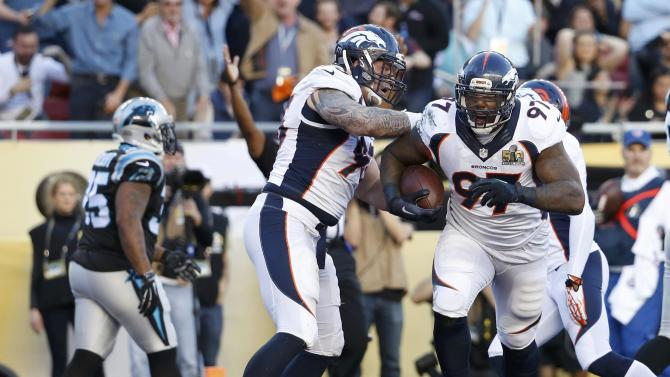 Denver Broncos' Jackson celebrates with Wolfe after recovering a fumble in the end zone for a touchdown against the Carolina Panthers during the NFL's Super Bowl 50 football game in Santa Clara