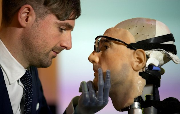 "Researcher Bertolt Meyer, a lifelong user of prosthetic technology and the model for ""Rex"", the world's first ""bionic man"", poses with the humanoid during a photo call at the Science Museum in London"