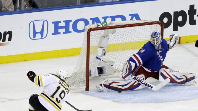 New York Rangers goalie Henrik Lundqvist (30), of Sweden, deflects a shot on the goal by Boston Bruins' Tyler Seguin (19) during the third period in Game 4 of the Eastern Conference semifinals in the NHL hockey Stanley Cup playoffs on Thursday, May 23, 2013, in New York. (AP Photo/Frank Franklin II)