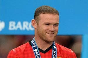 Cole: Rooney will stay at Old Trafford