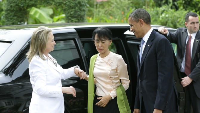 "Myanmar democracy activist Aung San Suu Kyi, center, greets U.S. President Barack Obama, right, and U.S. Secretary of State Hilary Rodham Clinton, left, at her residence in Yangon, Myanmar, Monday, Nov. 19, 2012. Launching a landmark visit to long shunned Myanmar, Obama said Monday he comes to ""extend the hand of friendship"" to a nation moving from persecution to peace. (AP Photo/Pablo Martinez Monsivais)"