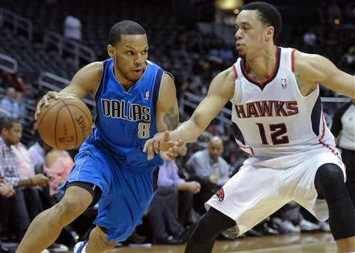 Hot-shooting Mavs roll past Hawks, 127-113