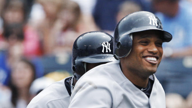 New York Yankees' Robinson Cano returns to the dugout after his grand slam in the third inning of a baseball game against the Kansas City Royals in Kansas City, Mo., Sunday, May 6, 2012. (AP Photo/Orlin Wagner)