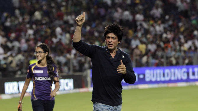 Kolkata Knight Riders' co owner and Bollywood star Shah Rukh Khan, center celebrates after his team won their Indian Premier League (IPL) cricket playoff match against Delhi Daredevils in Pune, India, Tuesday, May 22, 2012. (AP Photo/Rajanish Kakade)