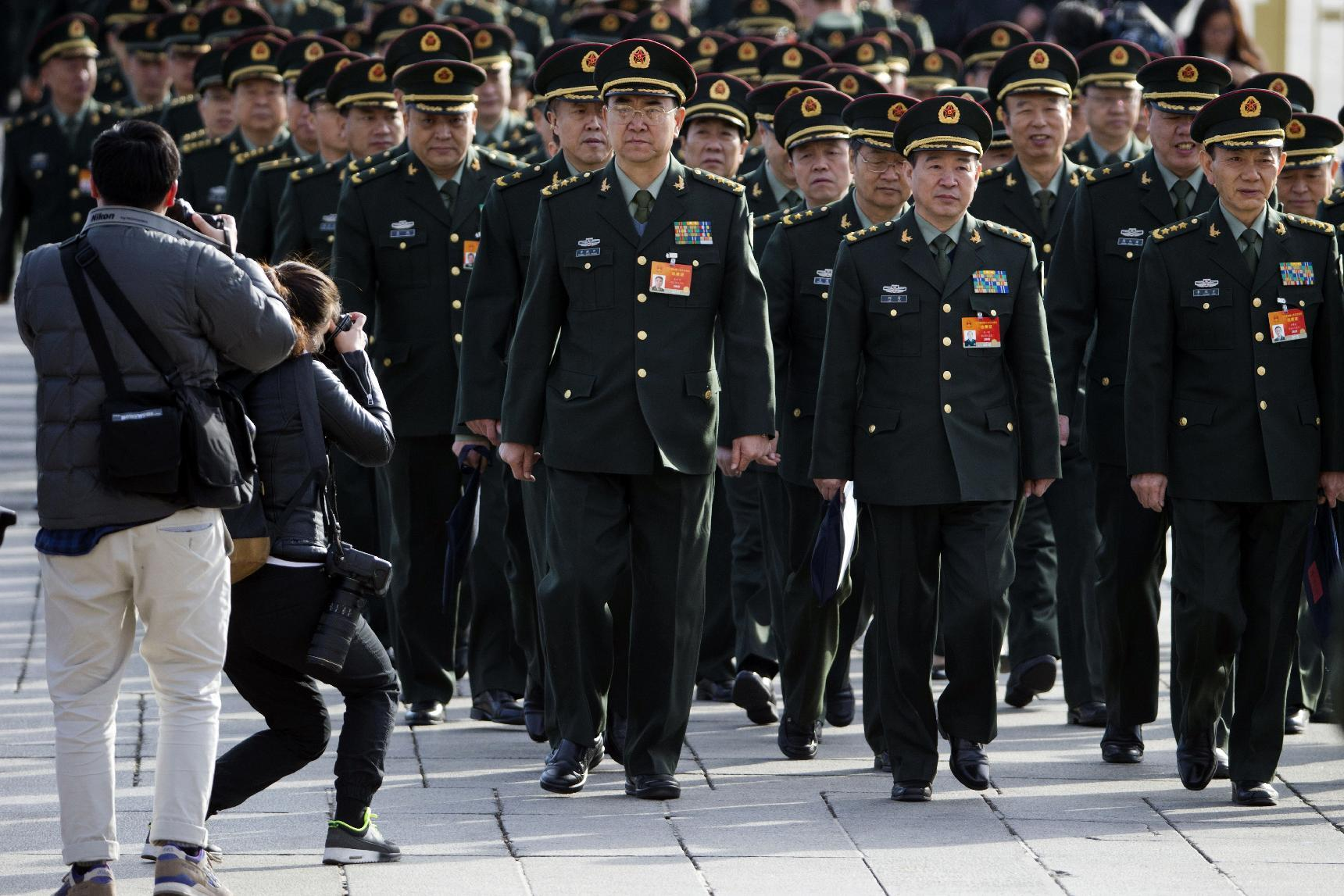 Official says China to boost military budget by 10 percent