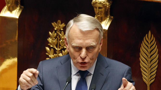 """French Prime Minister Jean-Marc Ayrault, delivers his first speech to the new Socialist-dominated parliament,  at the national Assembly in Paris, Tuesday July 3, 2012. France's new Socialist prime minister says the country's debts have become """"crushing,"""" laying the groundwork for expected spending cuts and tax hikes.(AP Photo/Remy de la Mauviniere)"""