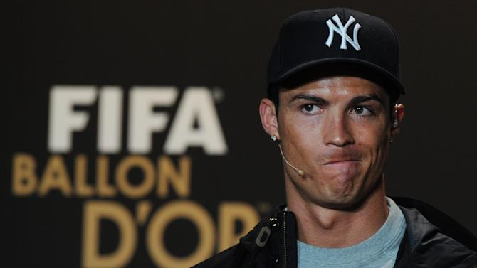 Cristiano Ronaldo of Portugal, one of the nominees for the FIFA Men's World Soccer Player of the Year Award, listens to a jpurnalists question during a press conference during the FIFA Ballon d'Or Gala 2013 held at the Kongresshaus in Zurich, Switzerland, on Monday, Jan. 7, 2013. (AP Photo/Keystone/Steffen Schmidt)