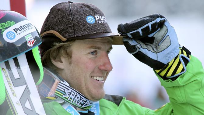 Ted Ligety, of the United States, smiles after setting the fastest time in the first run of an alpine ski, men's World Cup giant slalom, in Alta Badia, Italy, Sunday, Dec. 16, 2012. (AP Photo/Armando Trovati)